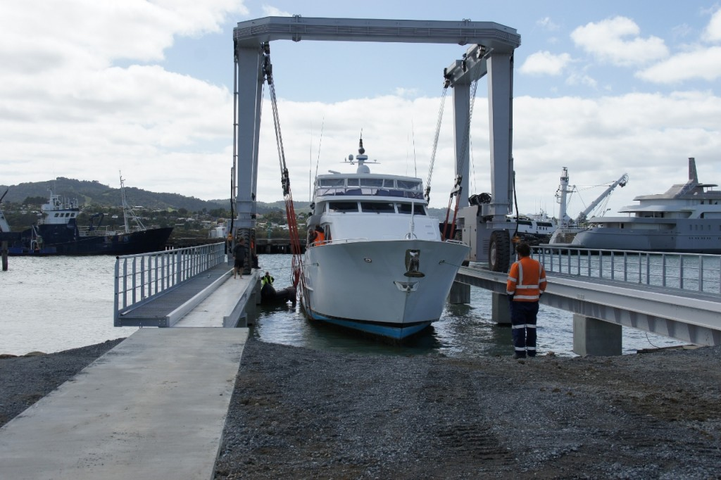 100' Broward Superyacht being lifted on new 100 tonne travelift at Port Whangarei Marine Centre, South Shipyard, Port Whangarei, New Zealand